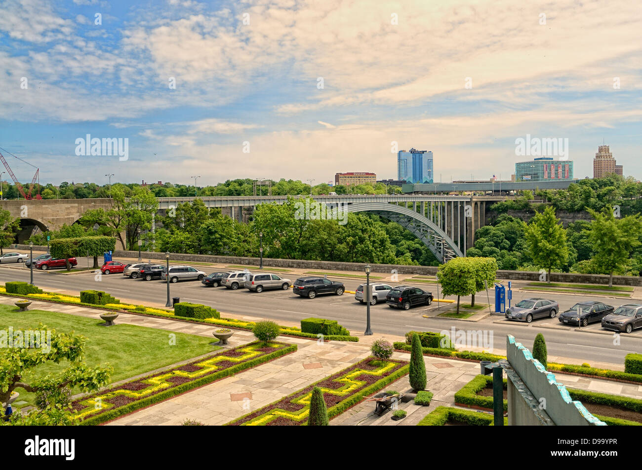 Part of the Oakes Garden Theatre on River Road in Niagara Falls Ontario Canada with the Rainbow Bridge and USA in - Stock Image