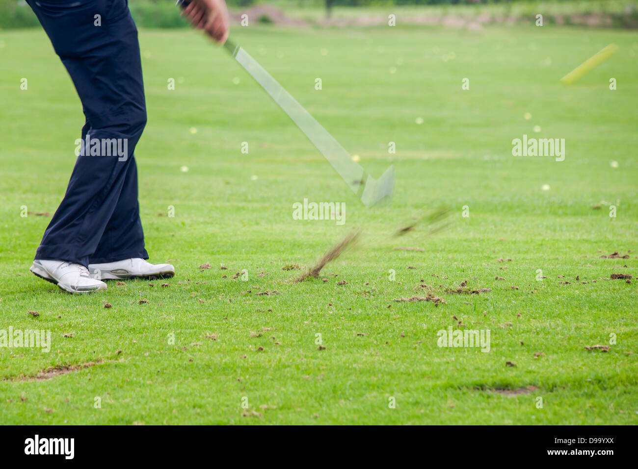 impact of a golf shot - Stock Image