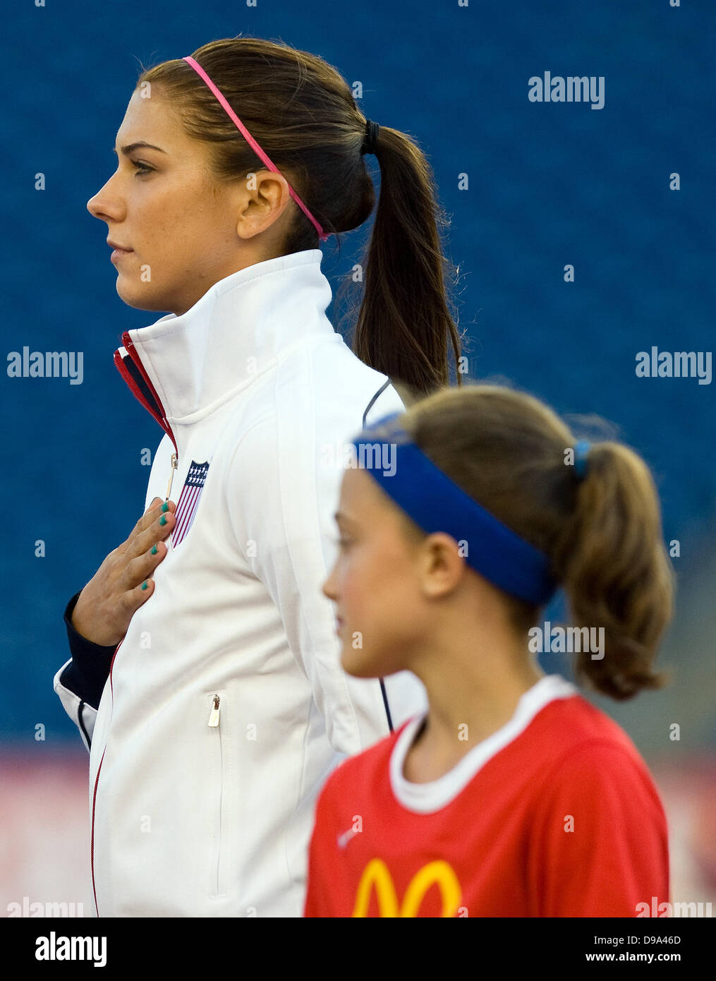 Foxborough, Massachusetts, United States. 15th June, 2013. USA forward Alex Morgan (13) during the National Anthem - Stock Image