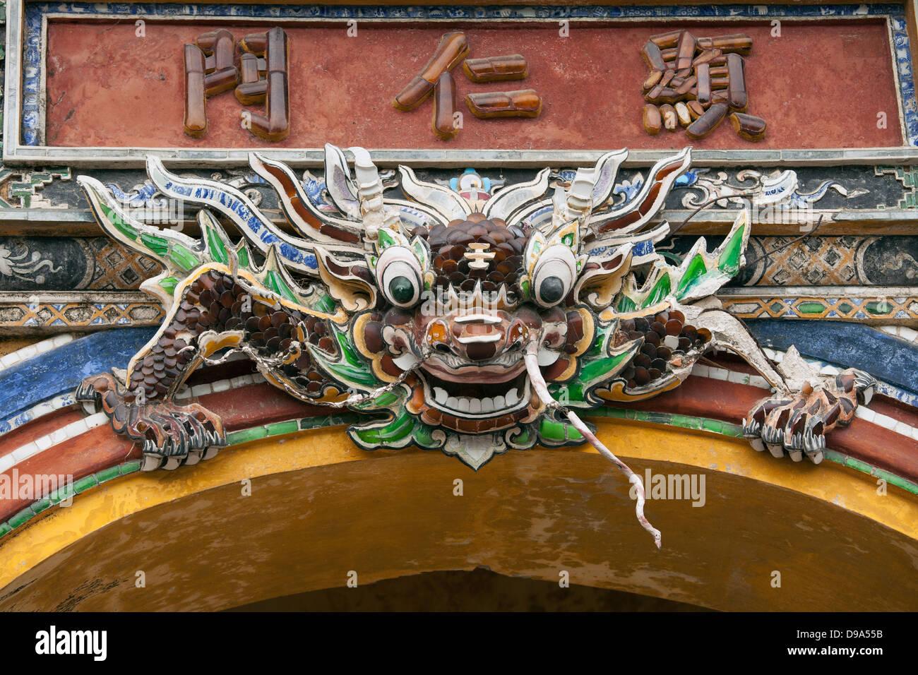 Detail of ceramic dragon on Hien Nhan gate in Citadel, Hue, Vietnam, Southeast Asia. - Stock Image