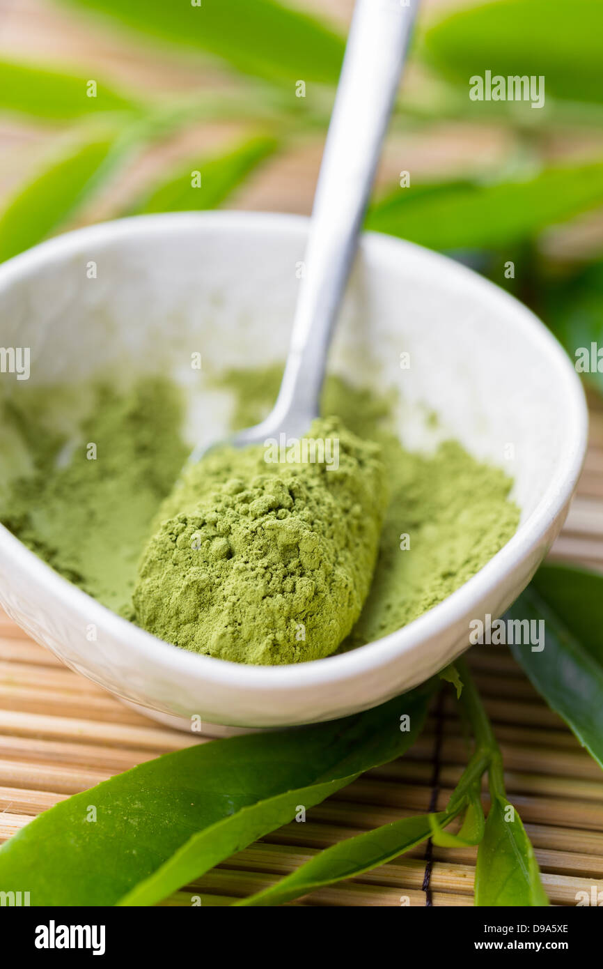 Powdered matcha tea in a bowl - Stock Image
