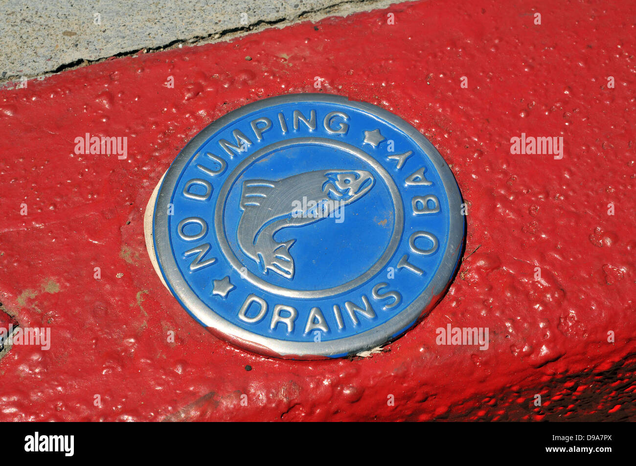 Anti-pollution sign on a sidewalk in Tiburon, California - showing that the culvert drains directly into San Francisco - Stock Image