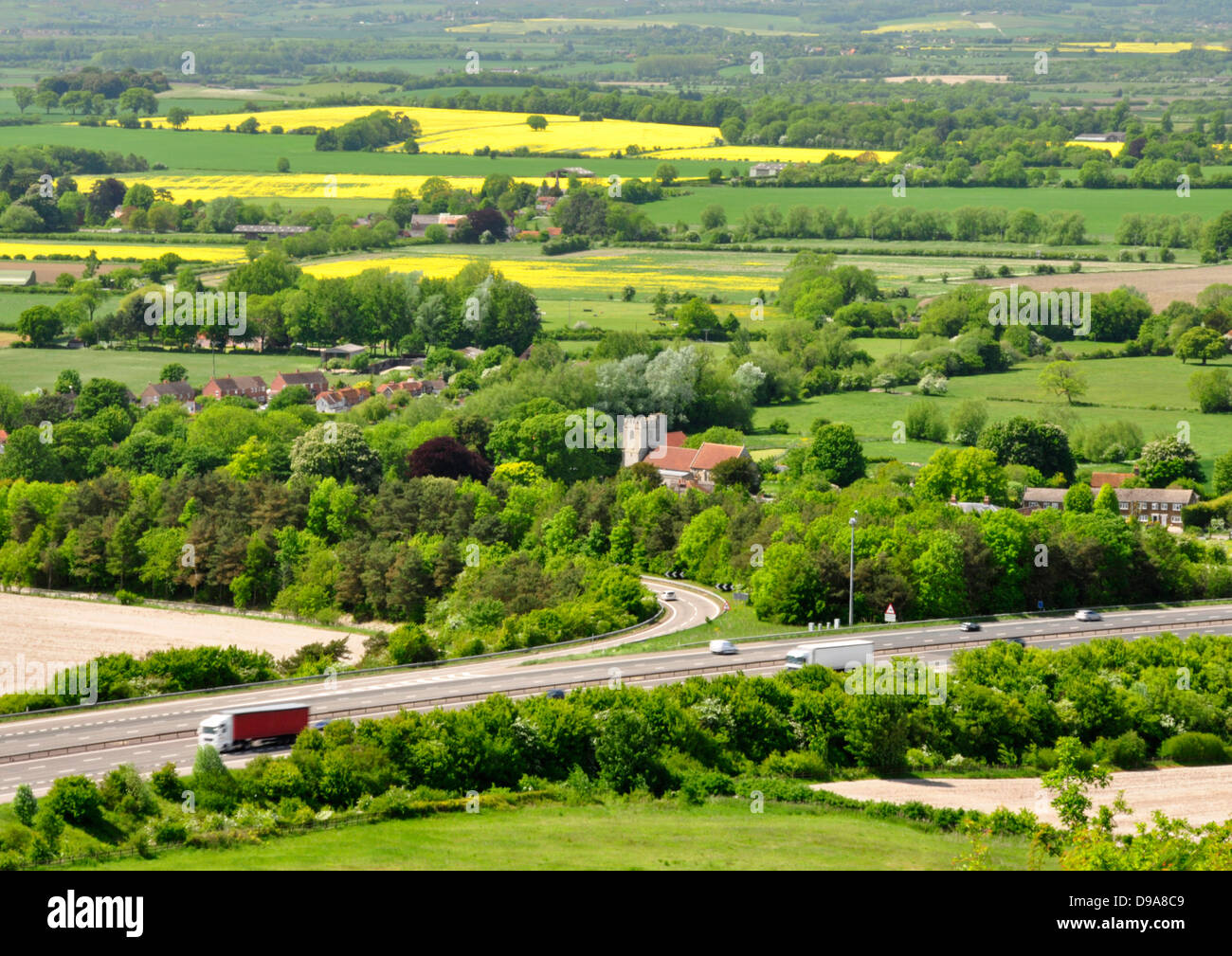 Oxon - Chiltern Hills -rural landscape - viewpoint above M40 and Lewknor village - trees and fields beyond - early - Stock Image