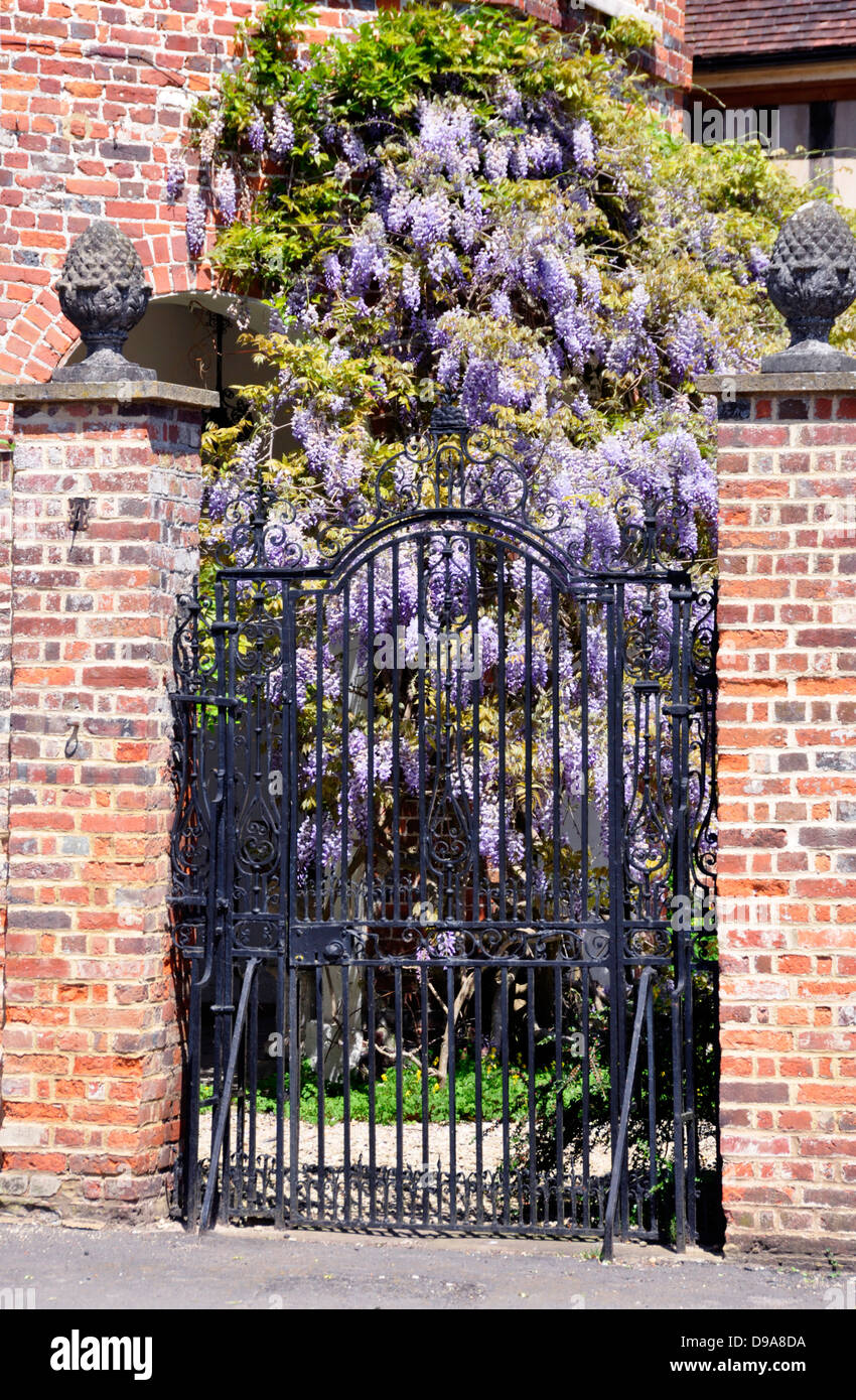 Bucks - Little Missenden - entrance gateway to the manor house - fine brick piers and wrought iron gate - wisteria - Stock Image