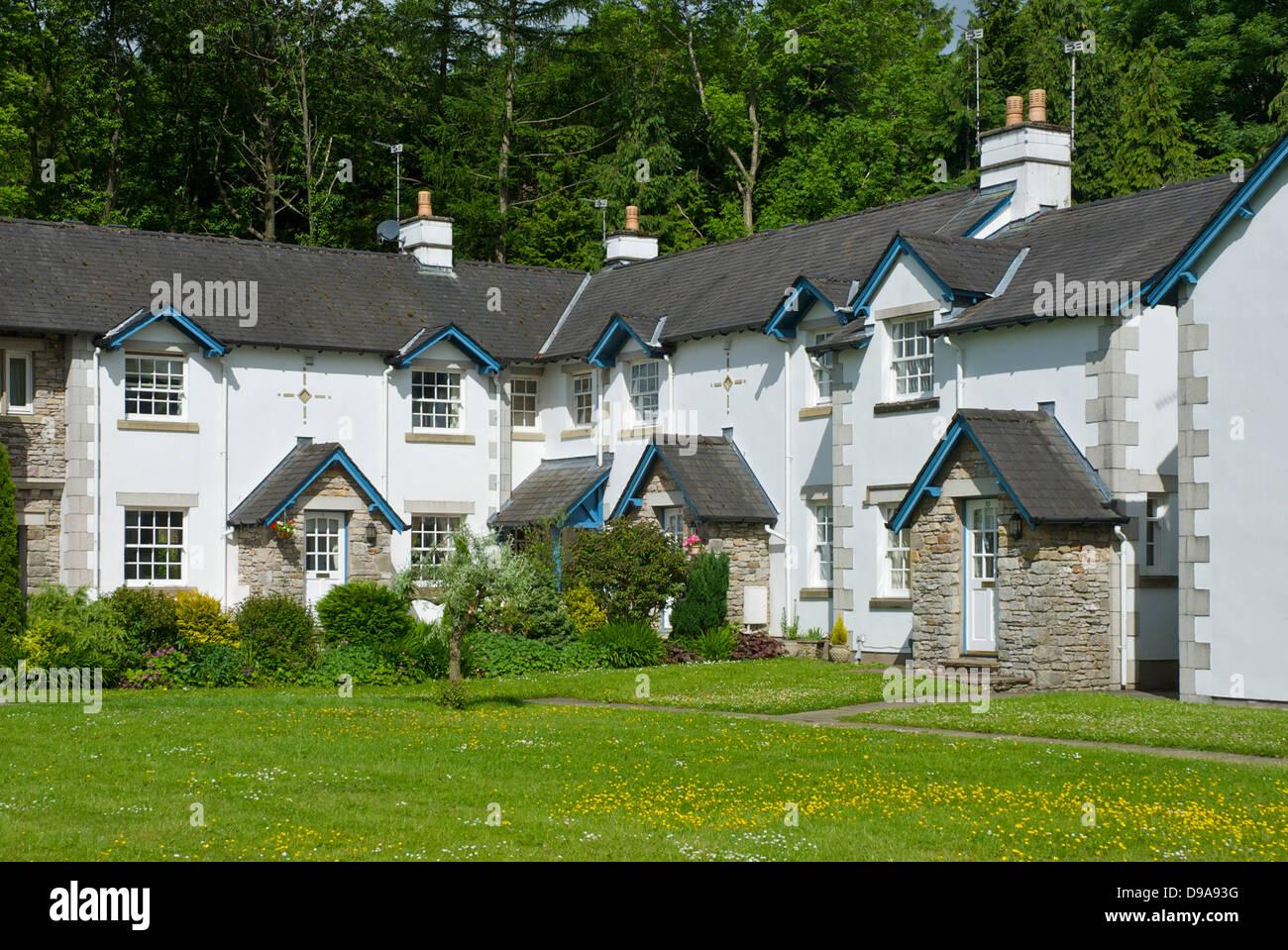Stylised houses in the Holker estate village, South Lakeland, Cumbria, England UK - Stock Image