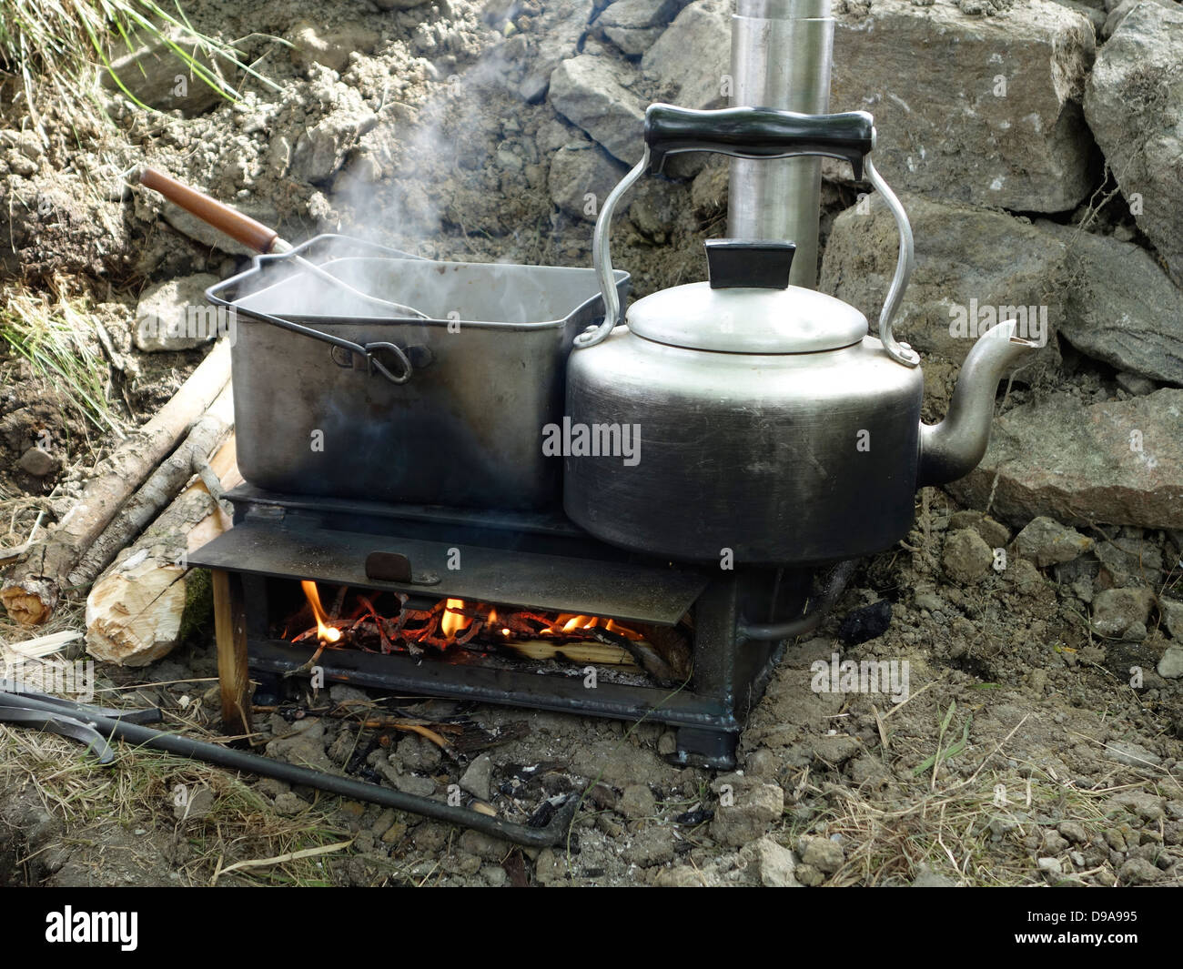 An improvised simple small wood-burning stove as used in trenches by British military in ww2. Re-enactment. - Stock Image