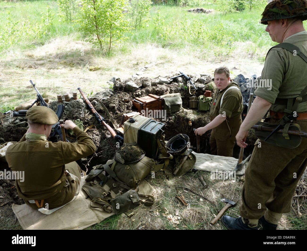 Historical re-enactment of ww2. British soldiers dig the trench. - Stock Image