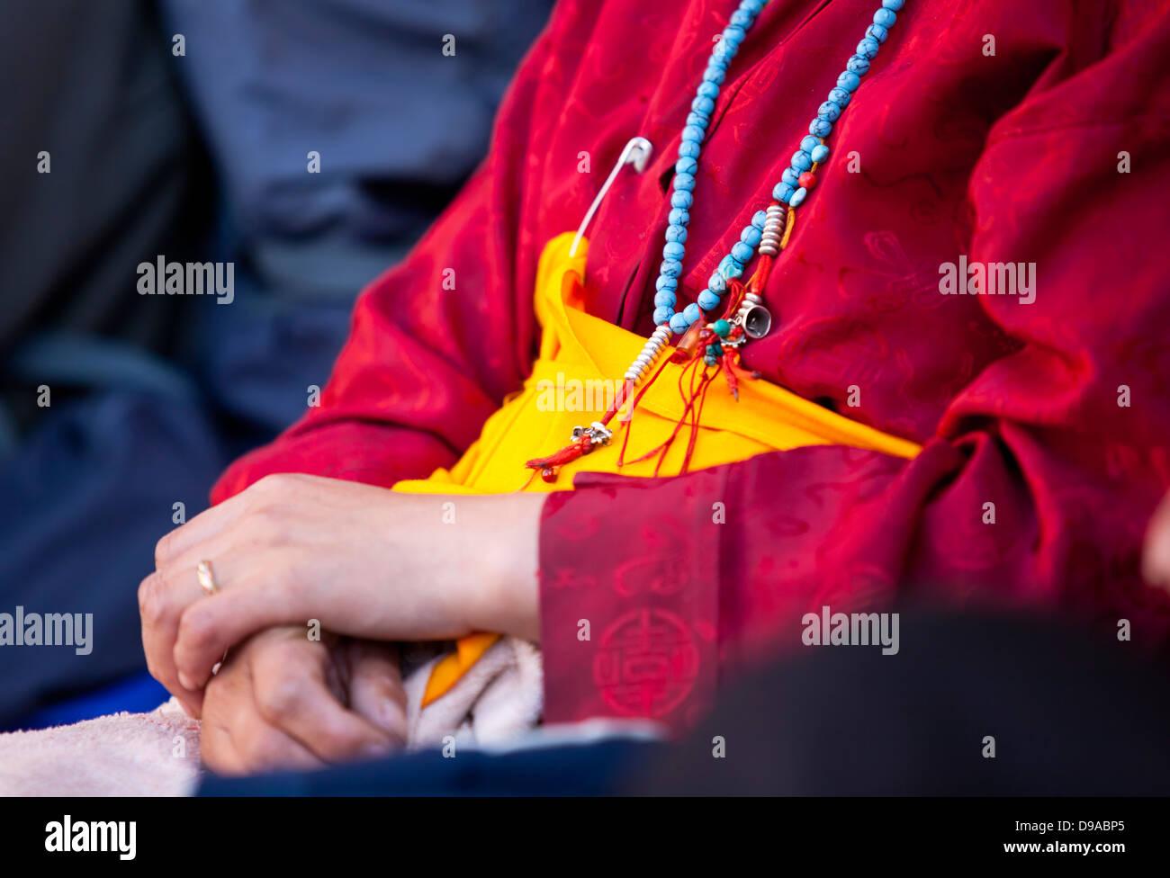 Tibet prayer with Buddhist beads - Stock Image