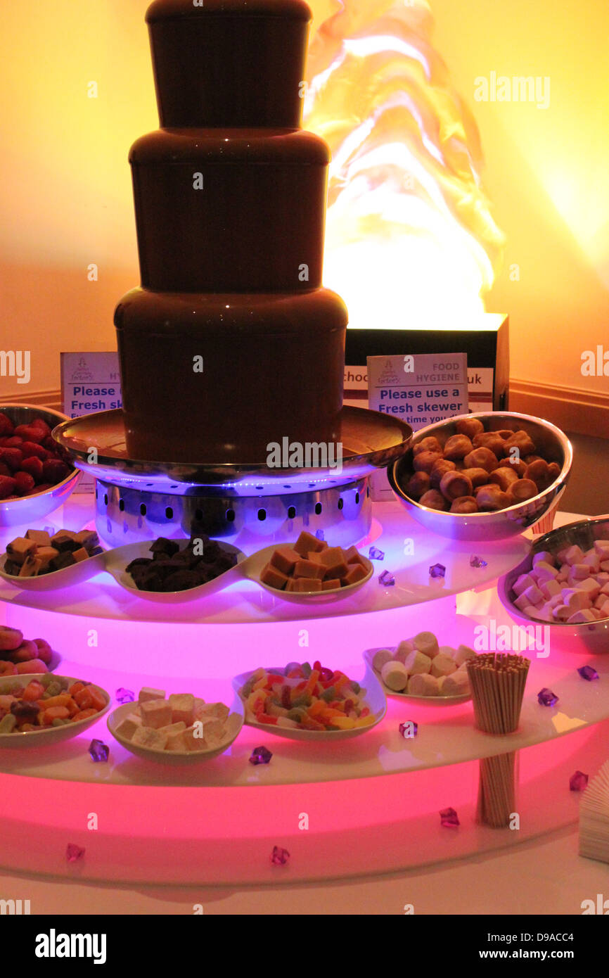 Giant Chocolate Fountain With Lots Of Dipping Bowls Stock Photo