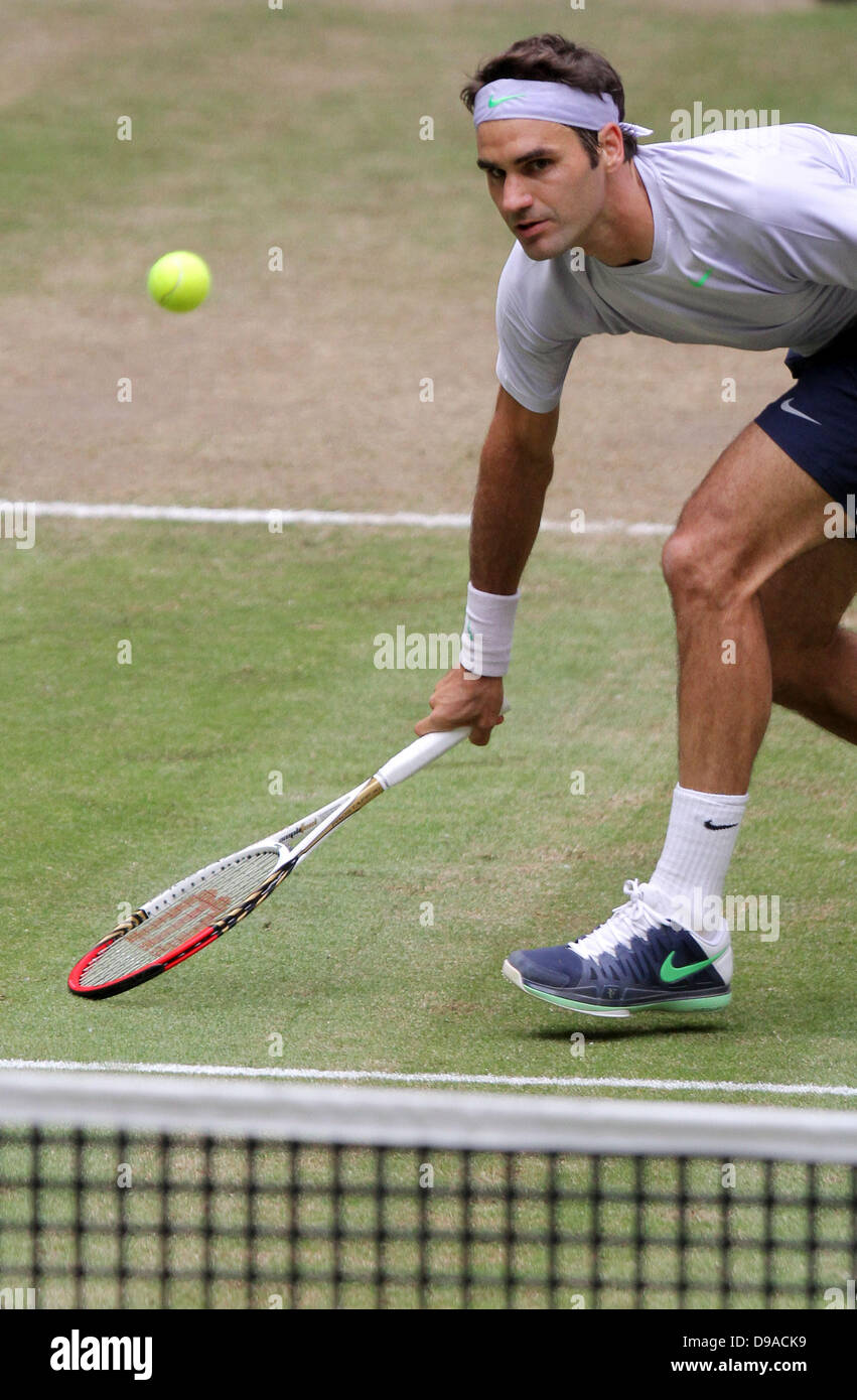 Halle/ Westphalia, Germany. 16th June, 2013. Swiss tennis player Roger Federer plays the ball during the final against Youzhny from Russia at the ATPtournament in Halle/ Westphalia, Germany, 16 June 2013. Photo:OLIVER KRATO/dpa/Alamy Live News Stock Photo