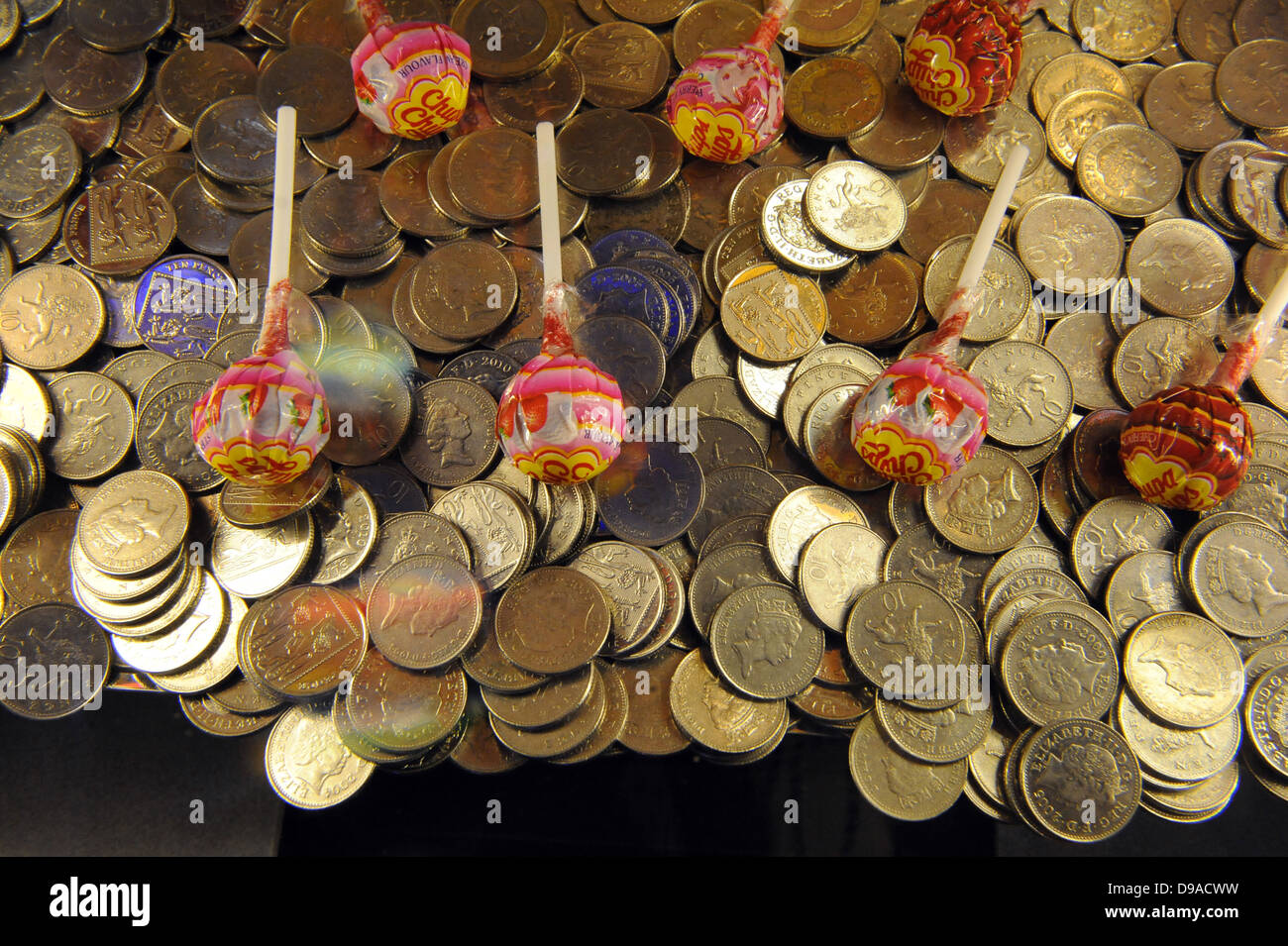A pusher type gambling machine in the Namco arcade in london, South Bank. uk - Stock Image