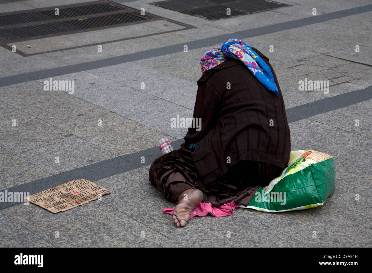 Gypsy woman begging in Madrid, Spain. - Stock Image