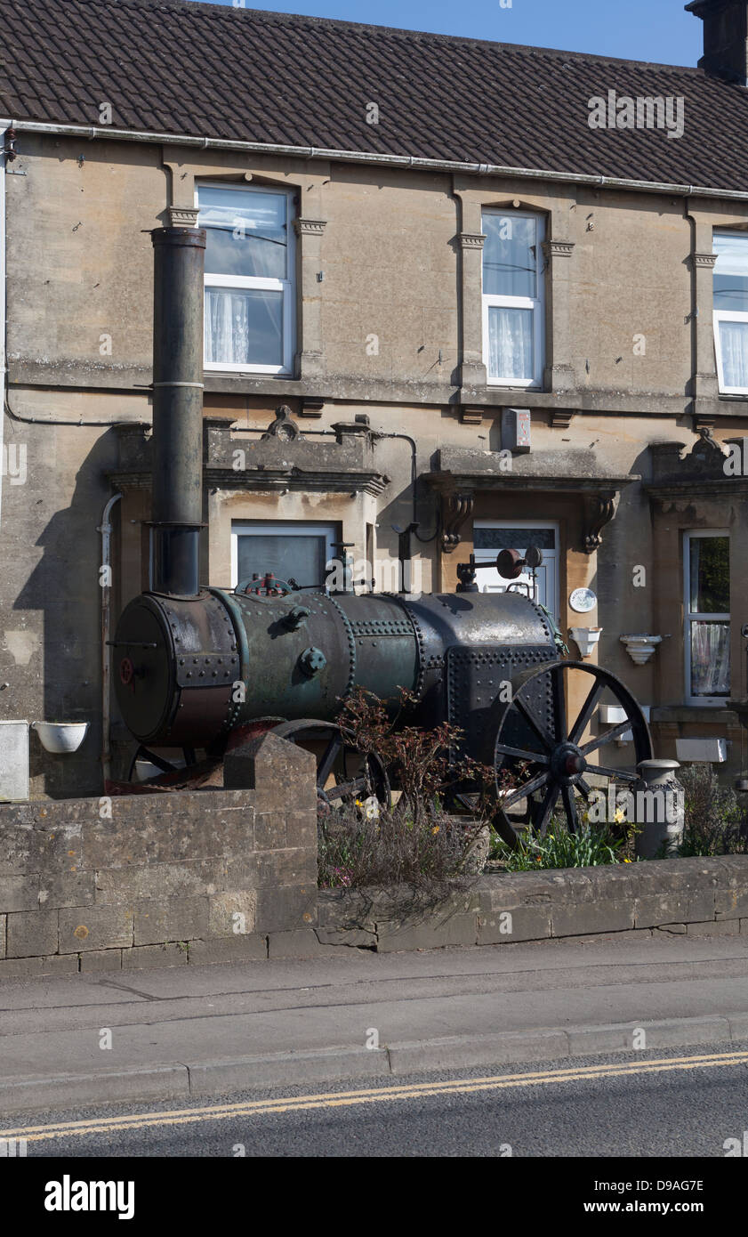 Old Steam Engine in the garden of house Box - Stock Image