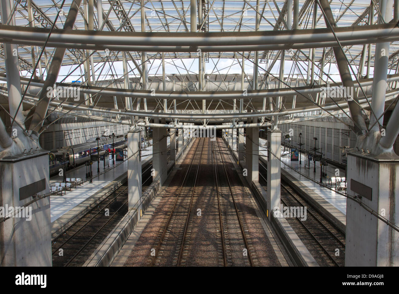 Train tracks leading into Chalres de Gaulle Train Station in Paris, France - Stock Image