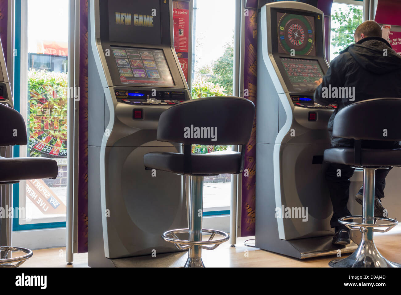 Roulette machines in Ladbrokes Bookmakers, England, UK Stock Photo