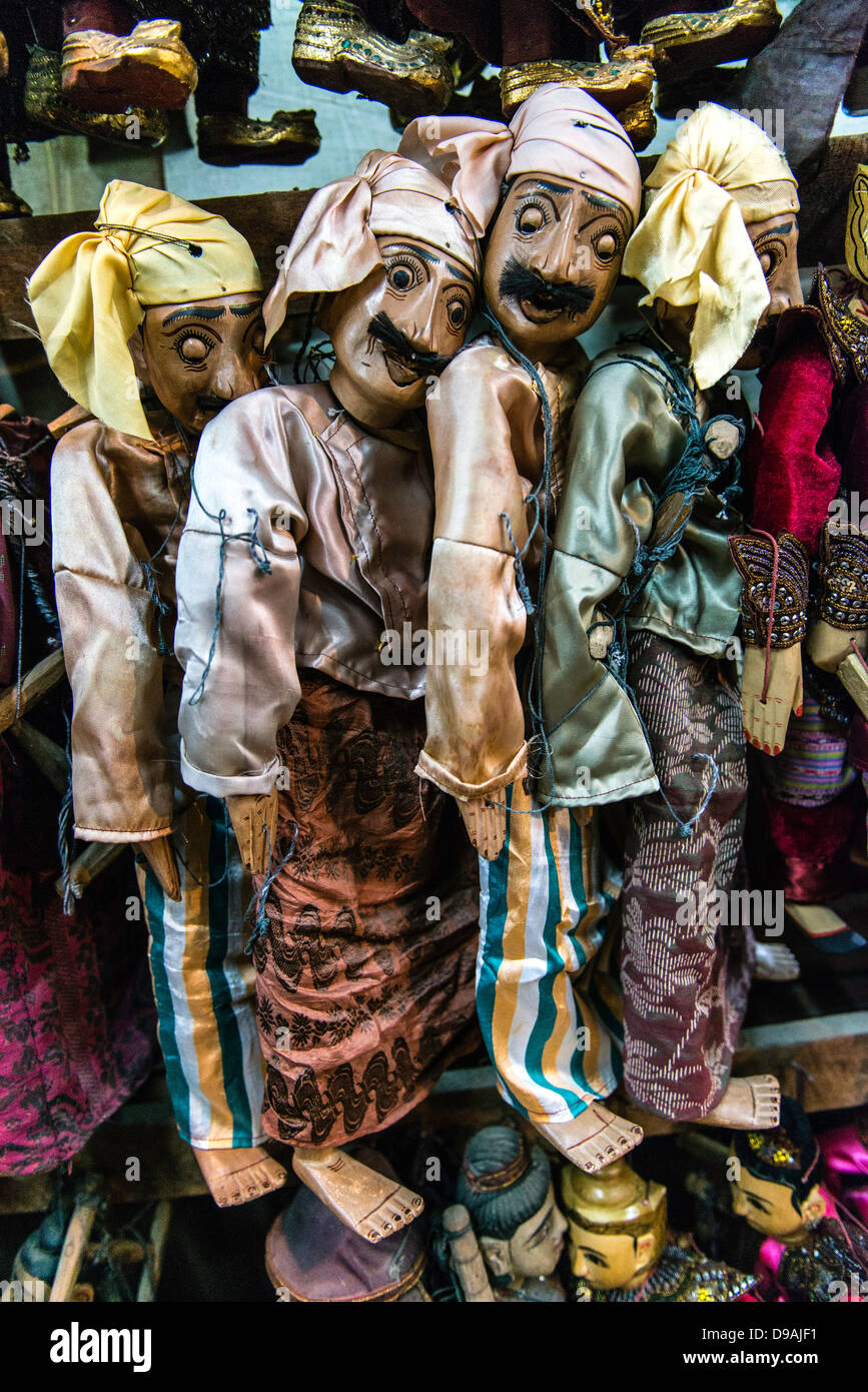 Burmese puppets hanging in a souvenir shop Burma Myanmar - Stock Image