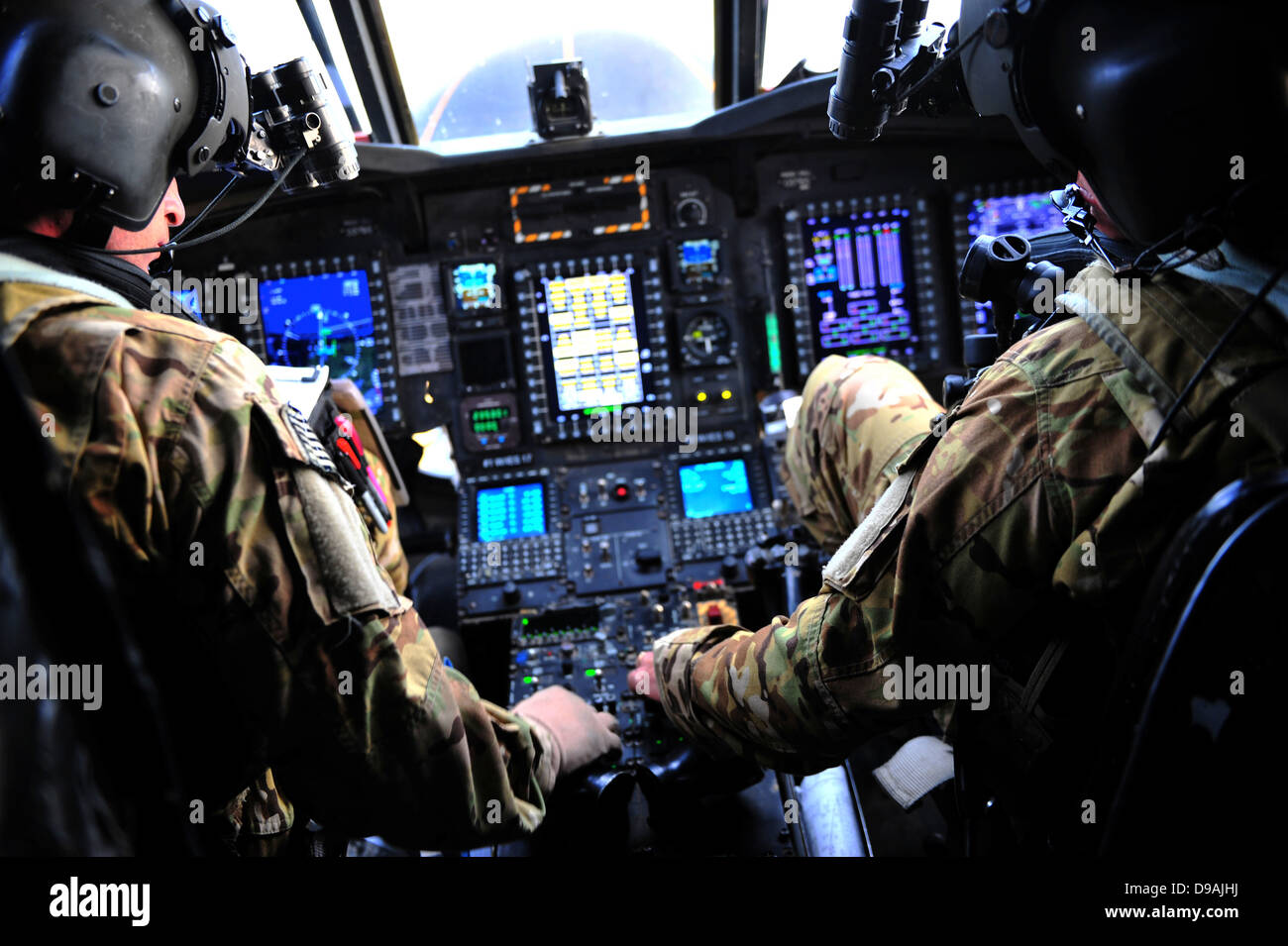 US Army MH-47G Chinook helicopter pilots perform preflight operations during a training operation April 29, 2013 - Stock Image