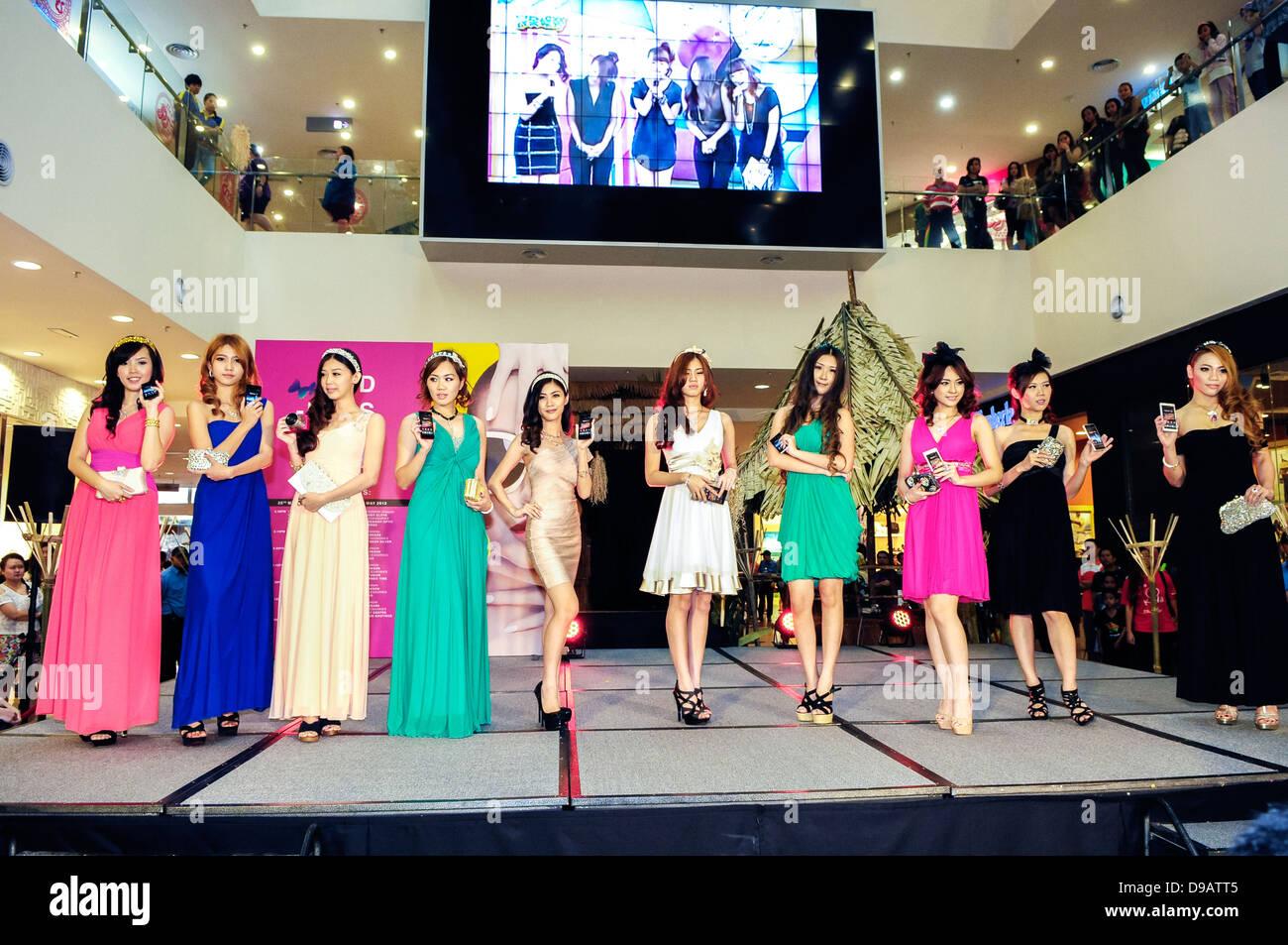 Models posing at Plaza Merdeka Fashion Week held on May 25, 2013 in Kuching, Malaysia - Stock Image