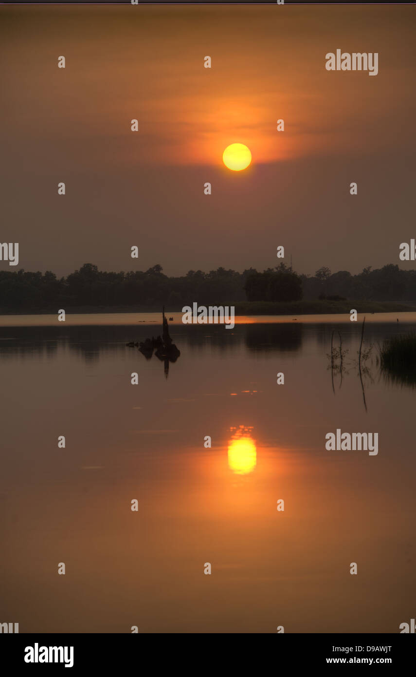Thai Sunsets. Taken near the reservoir in Surin, Northern Thailand. - Stock Image