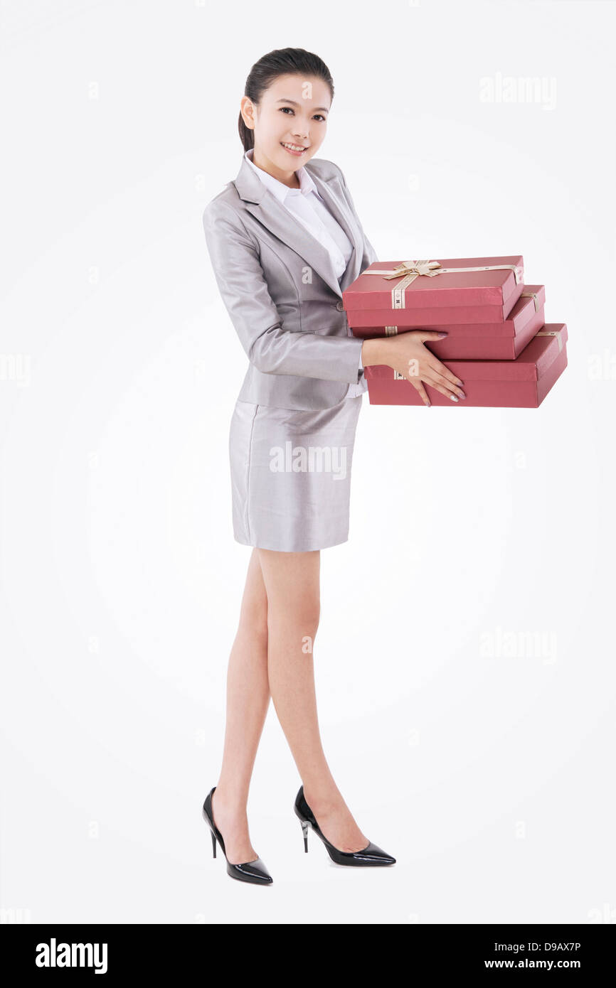 Oriental business woman with gift box - Stock Image
