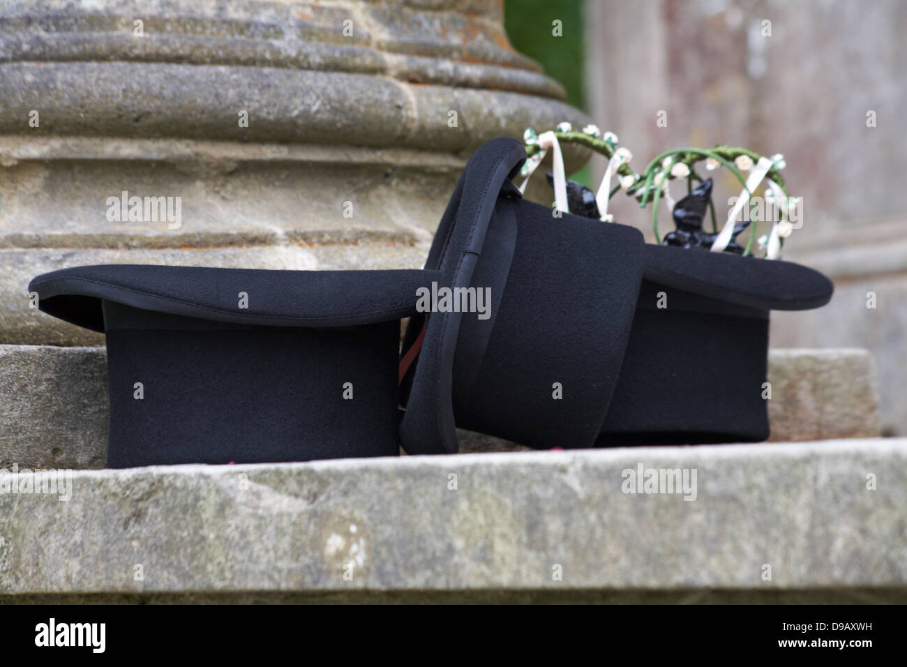 Top hats on step at wedding ceremony in June - Stock Image