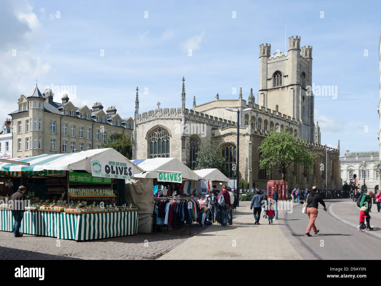 Cambridge UK. Market, pedestrians. Market street going into St Mary's Street. Great St Mary's Church. - Stock Image