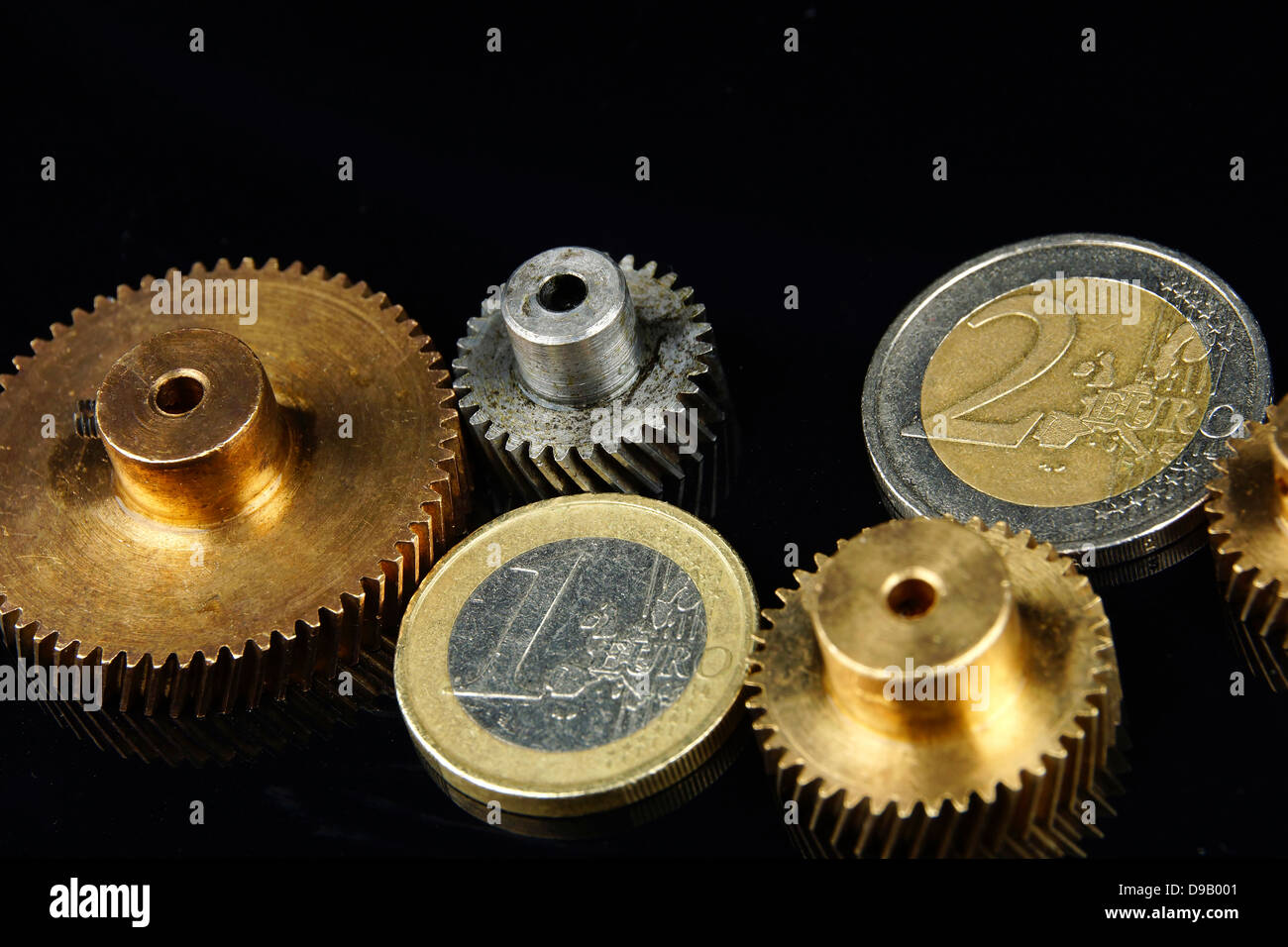 Euro coins as gearing part mechanism, close up - Stock Image