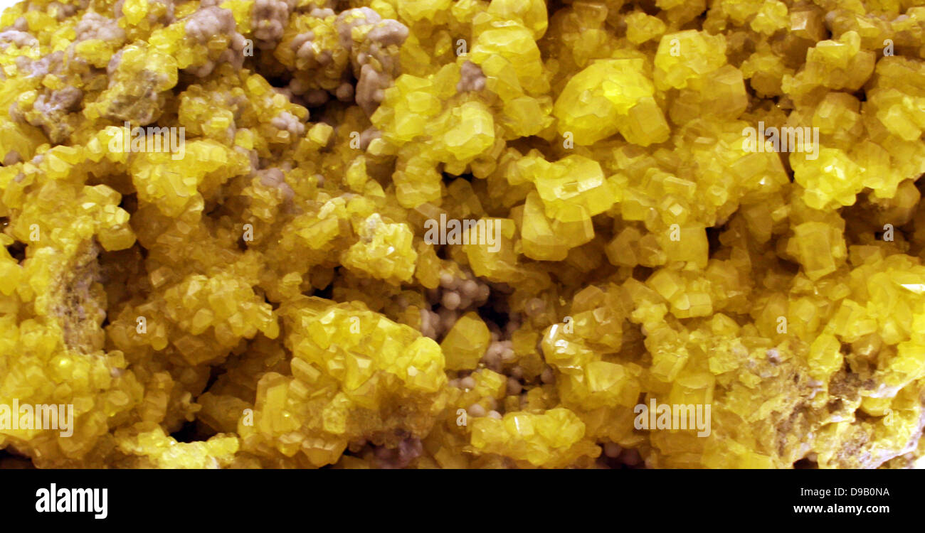 Sulphur crystals - Sulphur often forms around hot springs, volcanoes and vents where hot sulphur-rich gases are Stock Photo