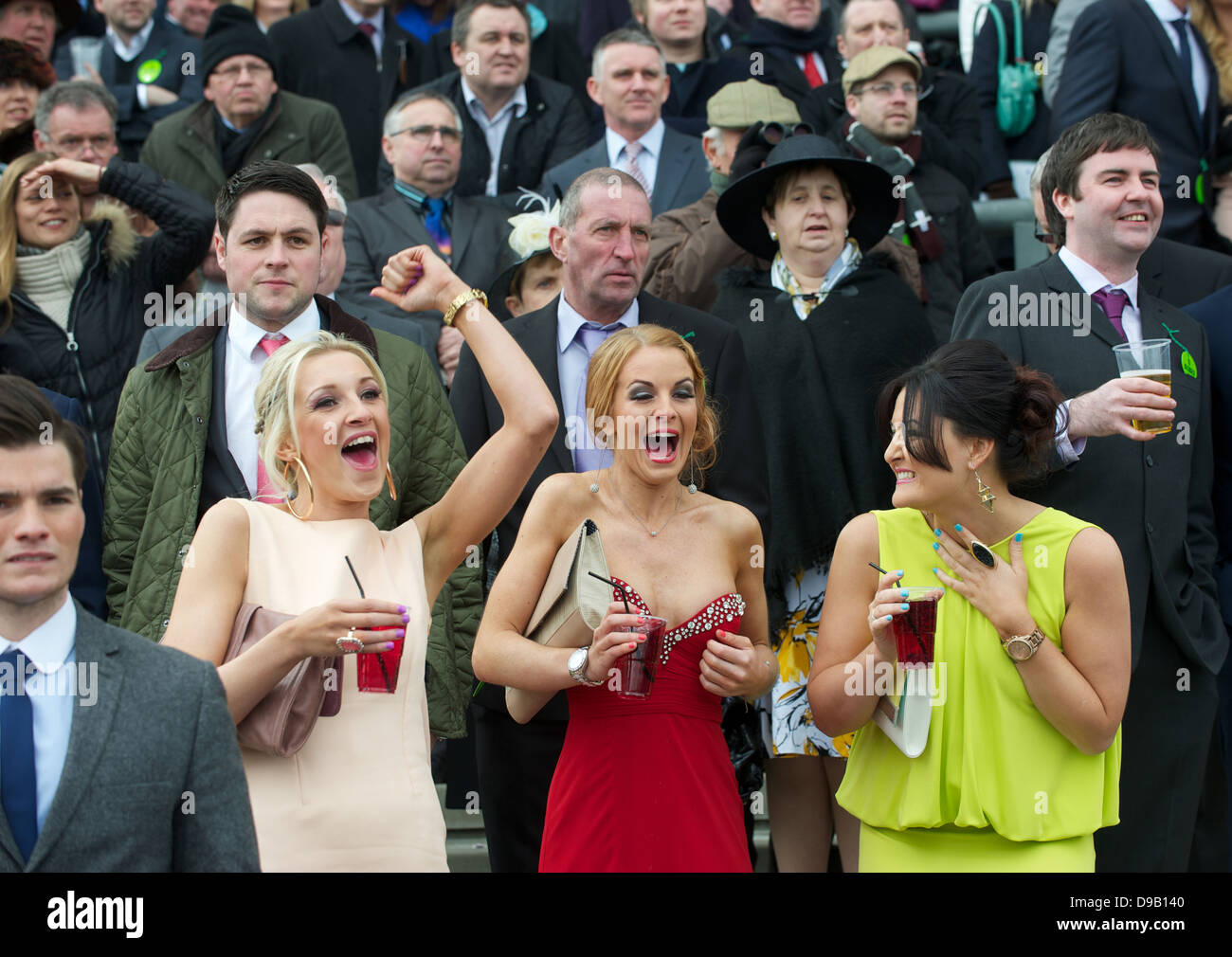 Spectators in the stands at Aintree for the GRAND NATIONAL  2013 Ladies day Stock Photo