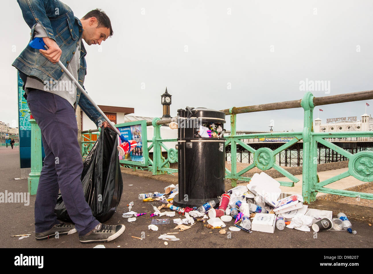 Brighton, UK. 17th June, 2013. Monday morning clean up - Brighton Pier workers clean up the mess as the city's cleaners Stock Photo