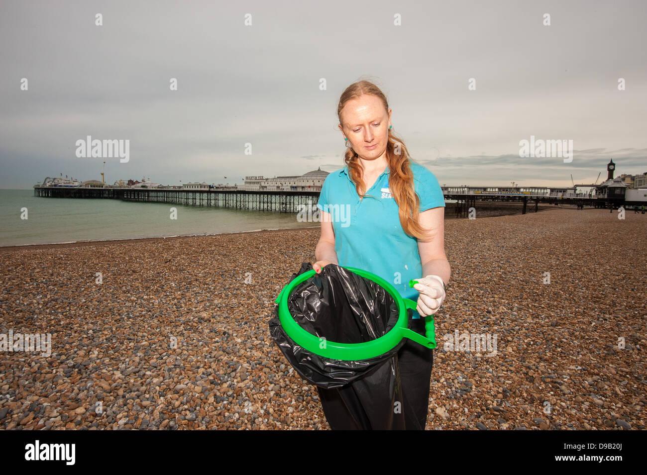 Brighton, UK. 17th June, 2013. Carey Duckworth, curator at  Brighton SeaLife Centre, examines litter dangerous to - Stock Image