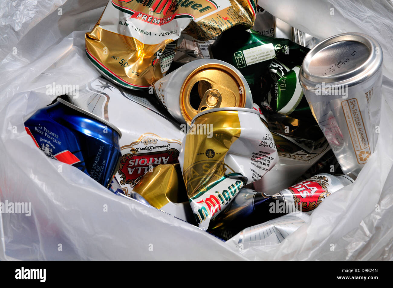 Beer cans in plastic bag to be recycled - Stock Image