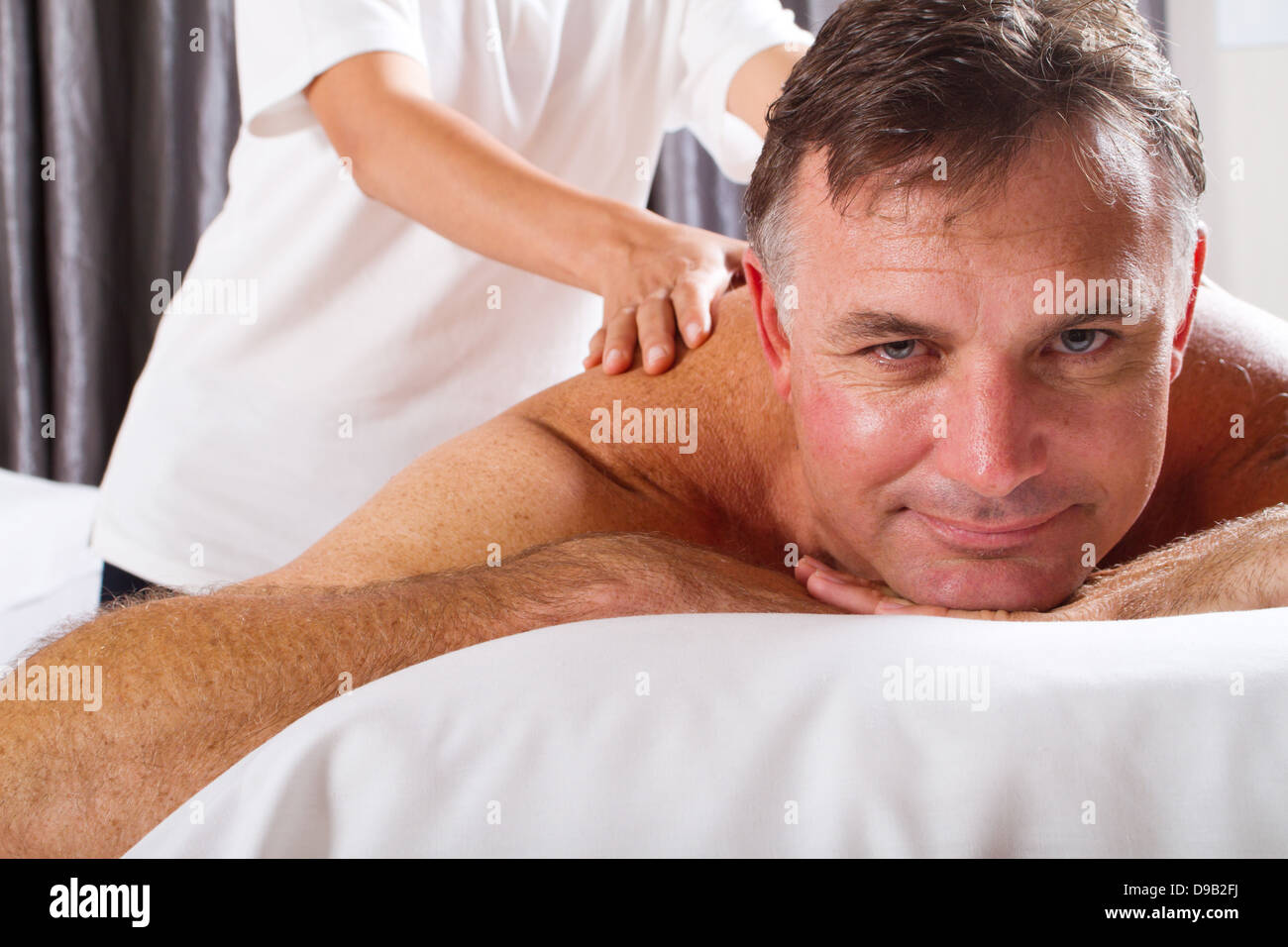 mature man having massage at spa salon - Stock Image