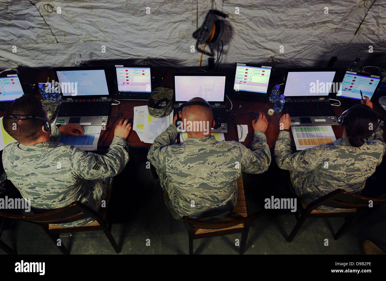 US Air Force airmen react to simulated threats from their regional Air Command Center during exercise Eagle Resolve - Stock Image