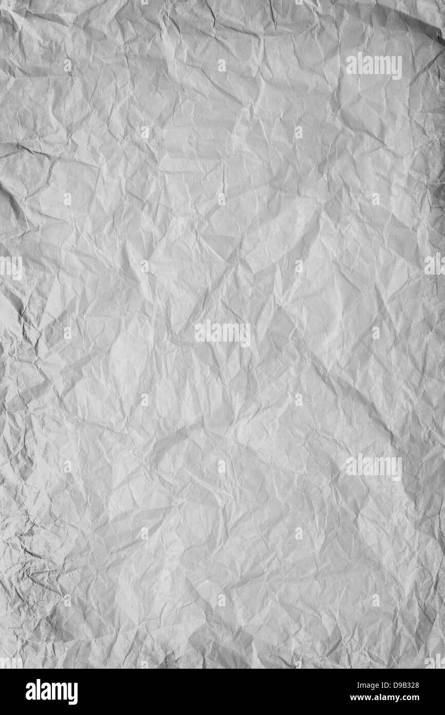 gray crumpled paper background or rough crumpled texture - Stock Image