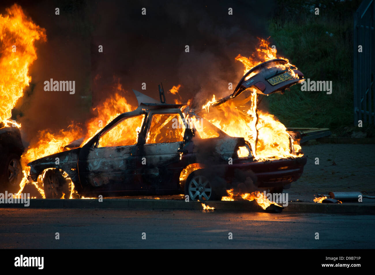 Car on fire rioting civil disturbance unrest - Stock Image