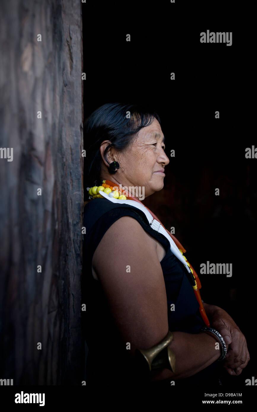 Naga tribeswoman in traditional outfit, Kisama, Kohima, Nagaland, India - Stock Image