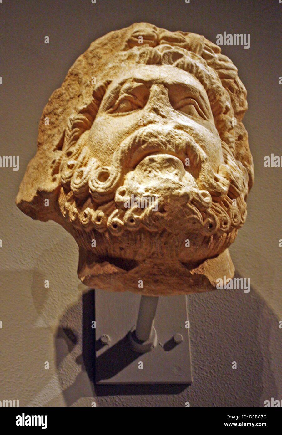Limestone Head of a Bearded Man, Possibly Jupiter.  South Italian, possibly Apolia.  Carved 1200-1300. Stock Photo