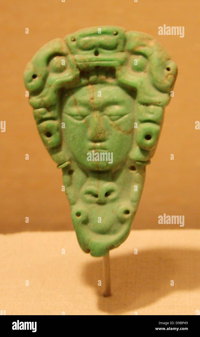 Head Pendant.  Mexico or Guatemala   Maya 5th-6th century.  Jade. - Stock Image