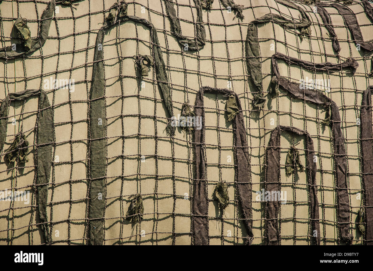Close detail of military Camouflage netting. - Stock Image
