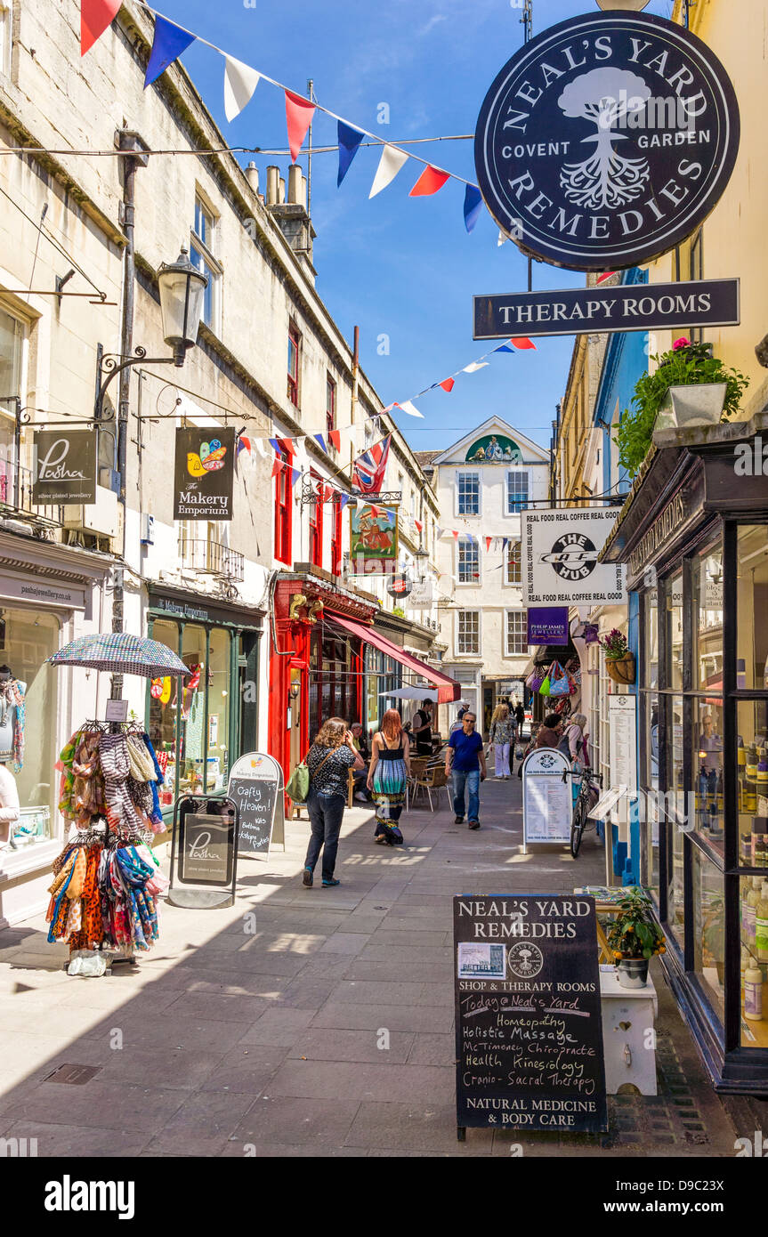 Shops in a shopping street in Bath, Somerset, England, UK - Stock Image