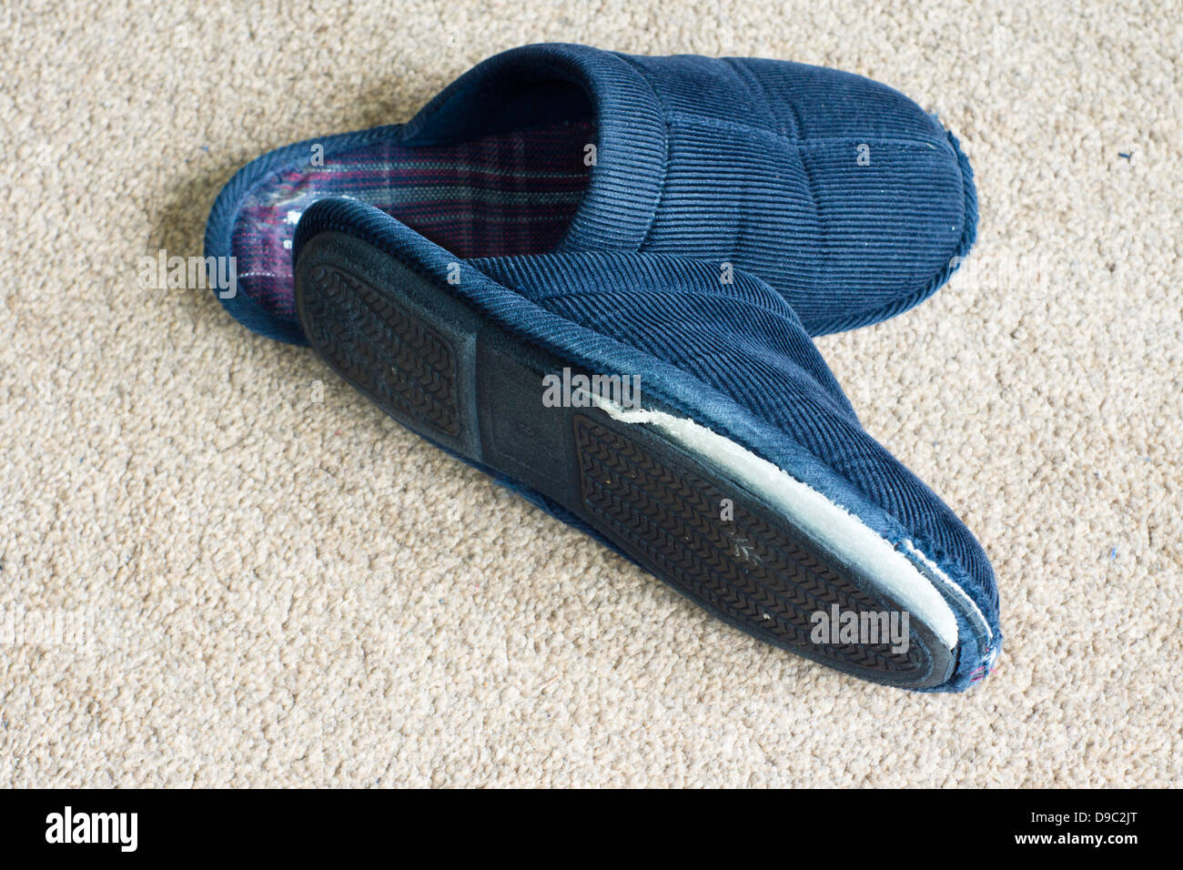 A pair of old work out slippers. - Stock Image
