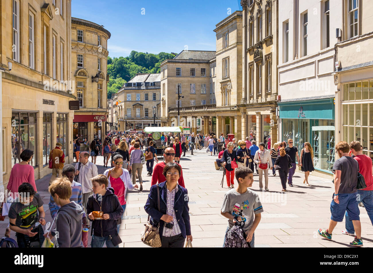 High street UK - Shoppers and shops in the high street in the city centre of Bath, Somerset, UK in summer - Stock Image