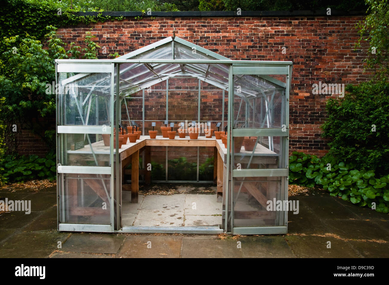 Poetry Art Installation by Alec Finlay ( Propagator ) within an aluminum greenhouse at the Yorkshire Sculpture Park. - Stock Image