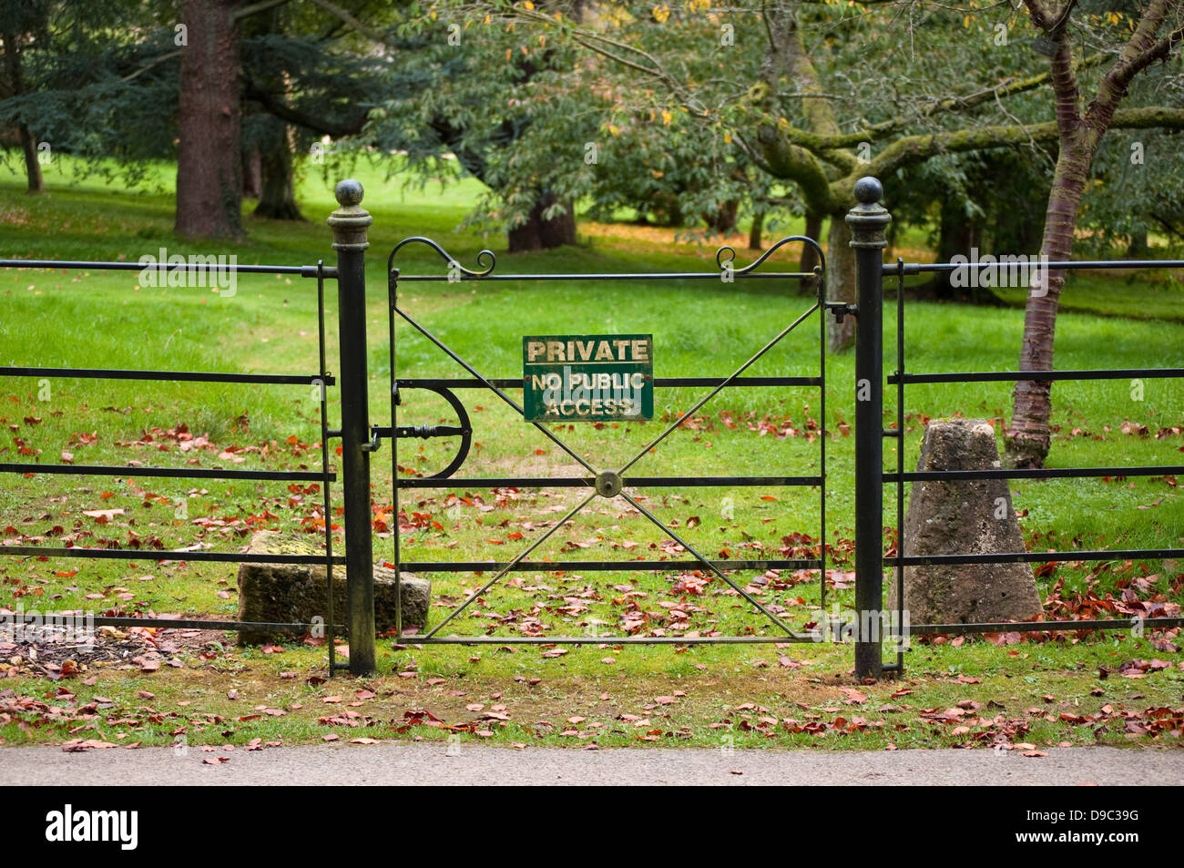 Metal Gate with fence and 'Private No Public Access' notice. - Stock Image