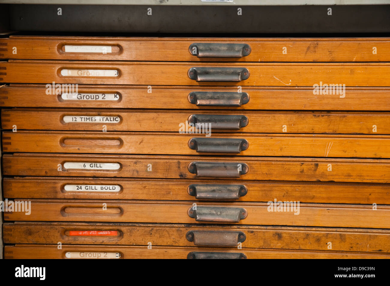 Drawers for storing printing letters labeled with the names of  various print type faces. UK - Stock Image