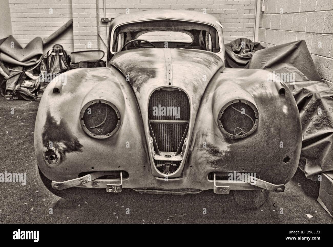 Jaguar XK140 classic car restoration garage British repair mechanic ...