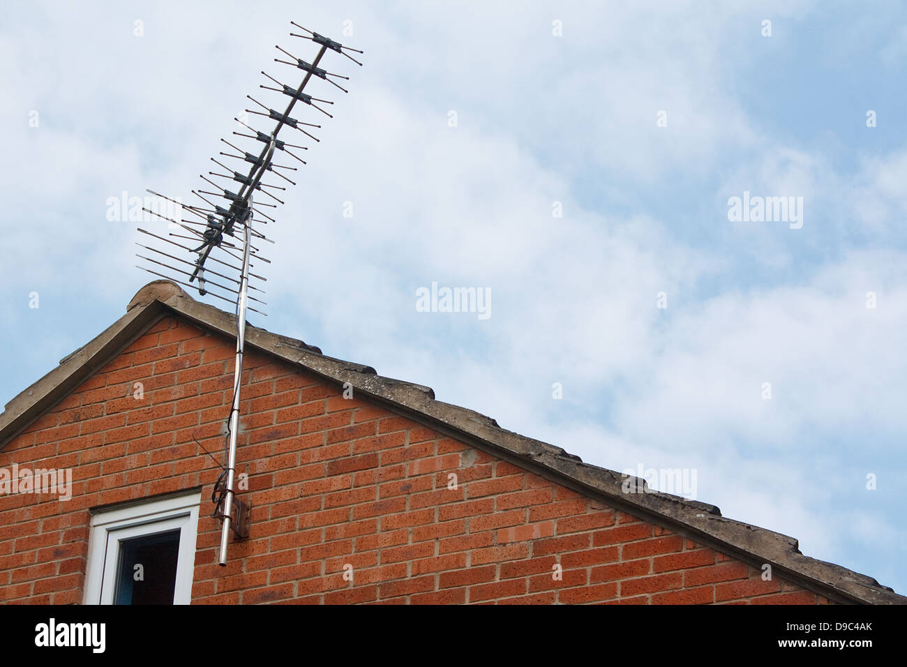 Terrestrial or digital television aerial fixed to the side wall of a modern house - Stock Image