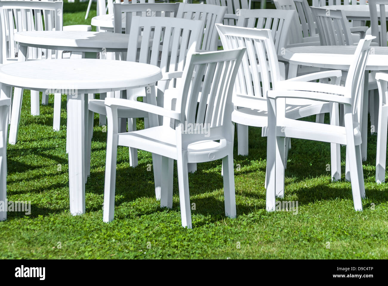 White plastic garden furniture on a lawn Stock Photo - Alamy