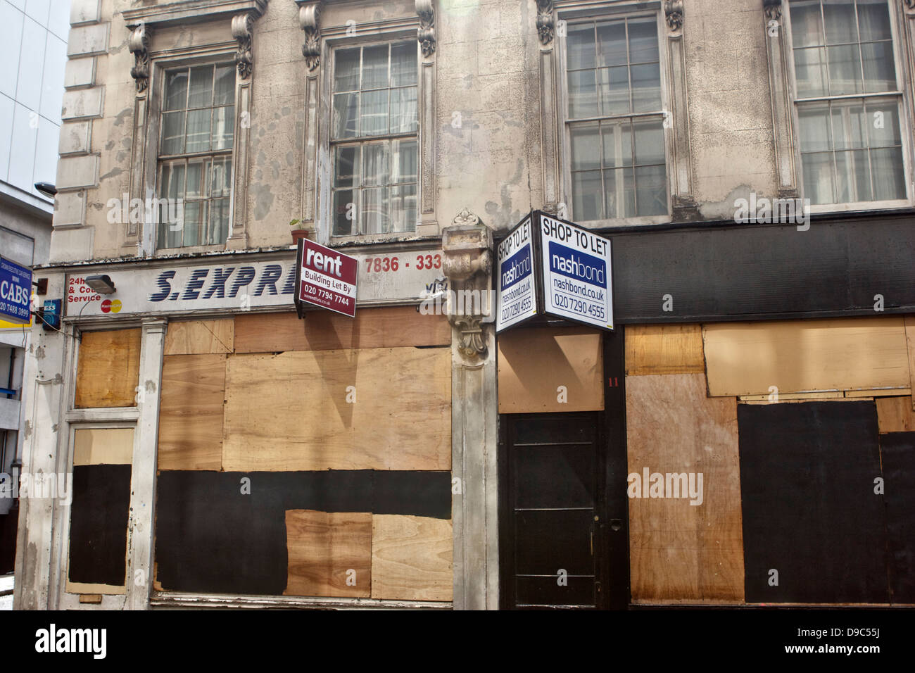 Deserted and boarded up shops in London's Bloomsbury District on Drury Lane - Stock Image